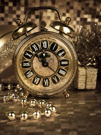 new year eve beads: Old alarm clock showing five to midnight on New Year