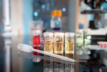 Liquid bacterial cultures on the bench  Stock Photo - 20970710