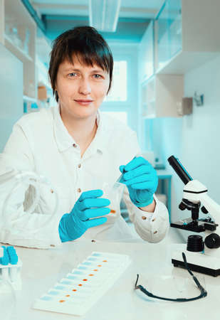 biopsy: Histopathologist or microscopist works with tissue samples