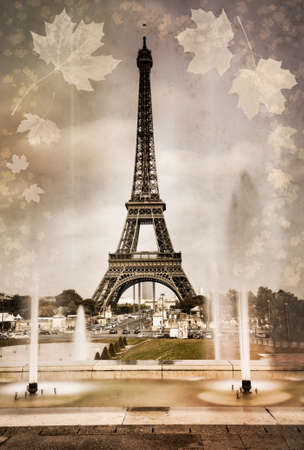 la tour eiffel: Aged photo of Eiffel Tower in Paris with autumn leaves  Retro style, vintage paper texture Stock Photo