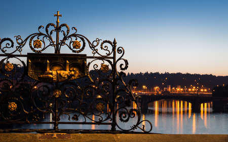 st charles: Statue of St  Jan Nepomucky on Charles Bridge in Prague at dawn, polished by thousands of hands
