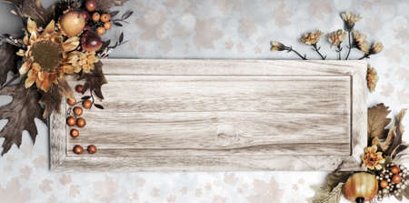 Wooden board with Autumn floral decorations on grey abstract background, space photo