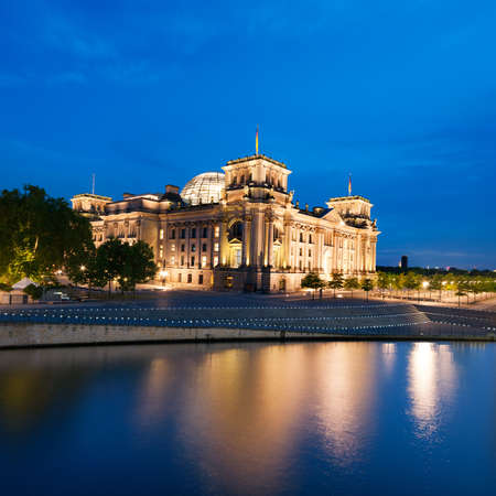 The Reichstag building  Bundestag  with reflection in river Spree at night