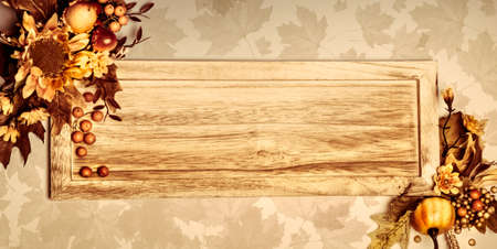 Wooden board on natural background, toned image, copy space photo