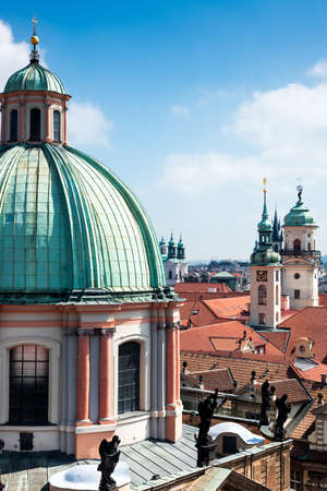 st  francis: Aerial view from Old Town Bridge Tower in Prague, closeup on St  Francis of Assisi Church Stock Photo
