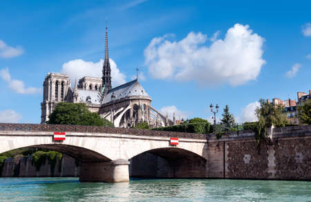 catholocism: View to Ile de la Cite, including Notre Dame Cathedral from across the river