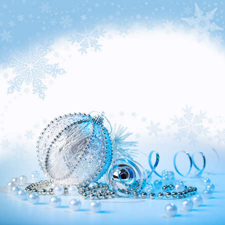 Xmas decorations on blue-white winter background, space photo