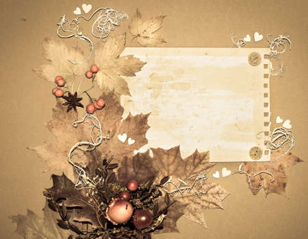 Paper frame decorated with autumn leaves, roots, rowanberries and cardboard hearts, space Stock Photo