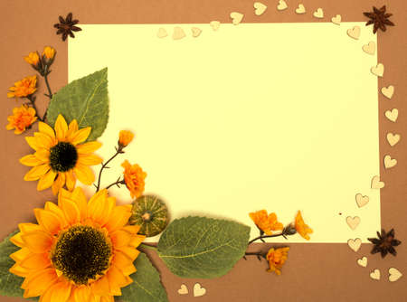 Paper frame decorated with sunflowers and cardboard hearts, space photo