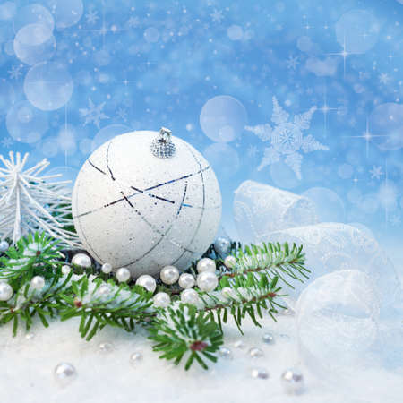 Silver Christmas decorations on abstract winter background, space photo