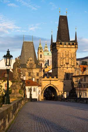 st charles: Prague, Morning light on Charles Bridge with St  Nicolas Church behind Bridge Tower Editorial