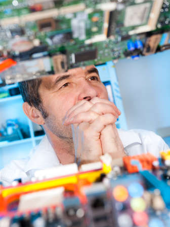 Senior radioelectronics repairman deep in thought Stock Photo - 22339138