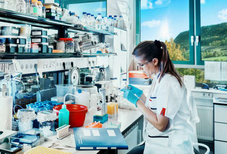 Young scientist works in modern biological lab  photo