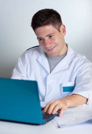 Young scientist works with laptop or netbook photo