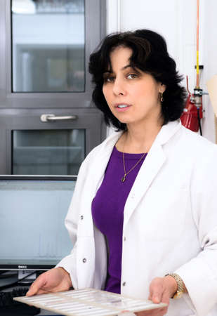 histological: Senior female scientist with histological samples Stock Photo
