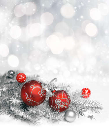 Red Christmas decorations with silver ornament on neutral winter
