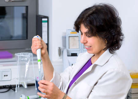 amplification: Senior scientist works with automatic pipette in biological laboratory