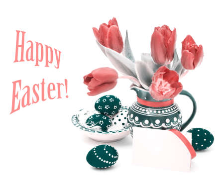 Turquoise Easter Eggs and tulips in matching vase, copy space photo
