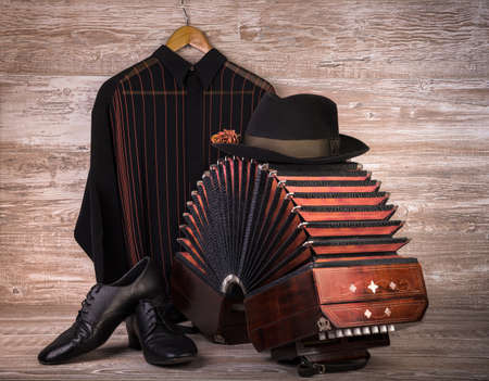 Argentine tango, still life composition with bandoneon on wooden  photo