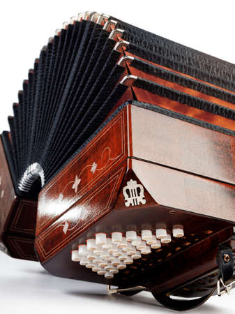 milonga: Close-up on bandoneon, tango instrument, on white background