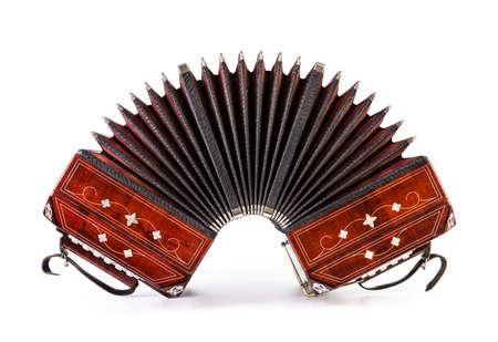 Close-up on bandoneon, tango instrument, on white background photo