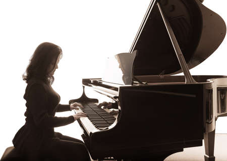 pianist: Young musician plays the grand piano, square composition Stock Photo