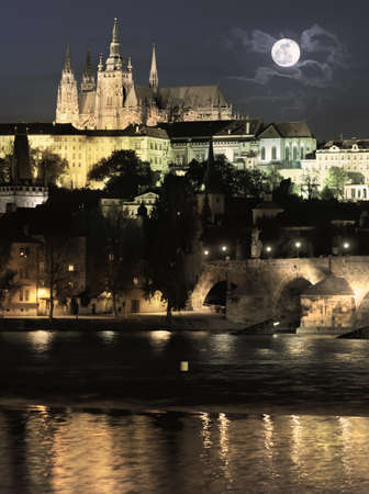 Evening view of  Prague Castle and Charles Bridge, tinted image photo