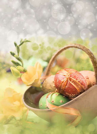 Easter composition with eggs and spring flowers, shallow DOF, text space