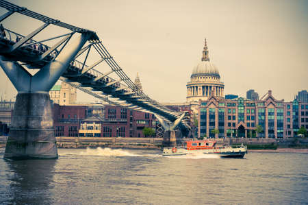 View on Millenium Bridge and St. Paul in London, tinted image photo