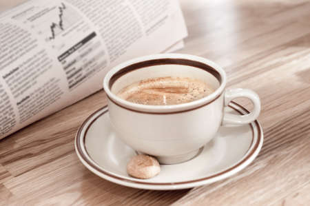 hot news: Coffee and morning newspaper with financial news