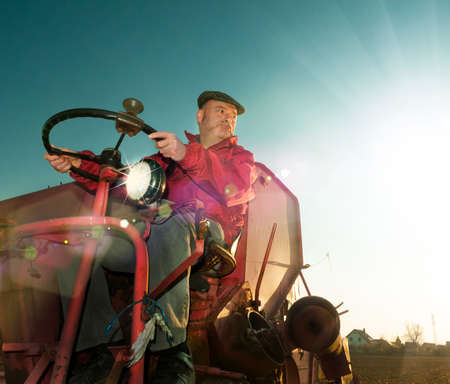 German farmer drives harvester, toned image, text space