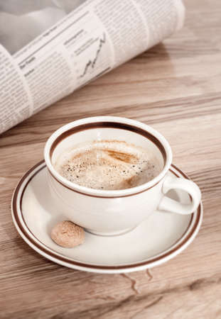 news update: Coffee and morning newspaper with financial news