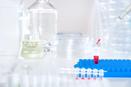 eppendorf: Loading biological sample into disposable plastic tube for analysis, text space Stock Photo