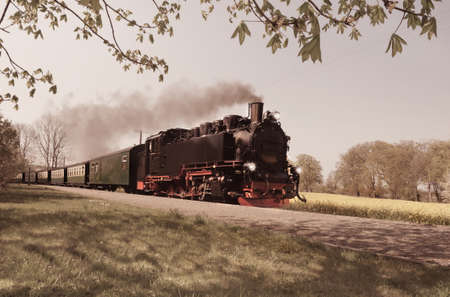 Historical steam train on island Rugen in Germany, toned image photo