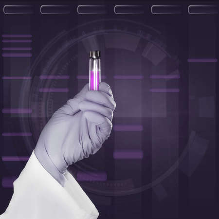 nitril: Gloved hand holds a liquid sample in plastic tube in front of dark scientific background