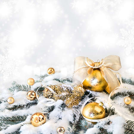 organza: Golden Christmas decorations on abstract winter background, text space