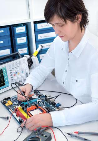 hardware repair: Senior electronics repairman works at hardware repair center