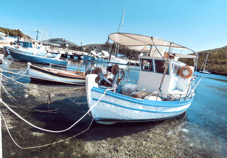 Fishermen boats at Kalamitsi harbor in Sithonia, Northern Greece, toned image photo