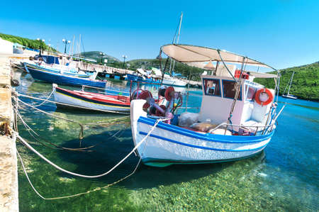 Fishermen boats at Kalamitsi harbor in Sithonia, Northern Greece photo