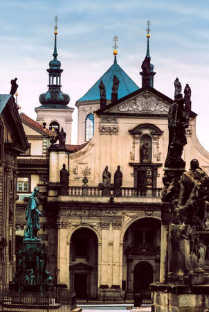 salvator: Kostel of of St. Salvator (Salvator Church) and towers of Clementinum in Prague early morning, toned image