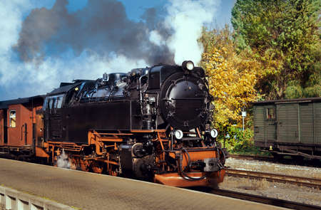 buffers: Historical German steam train by a platform Stock Photo