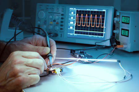 laboratory test: Tech tests electronic equipment in service facility