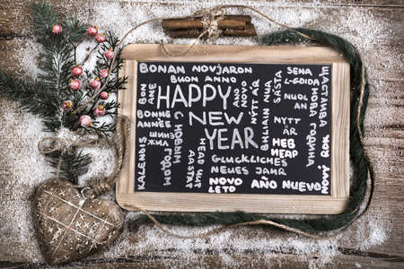 Black charcoal board with caption Happy New Year photo