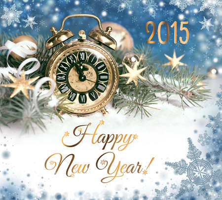 Happy New Year 2015! Old alarm clock set to five to twelve decorated for New Year photo