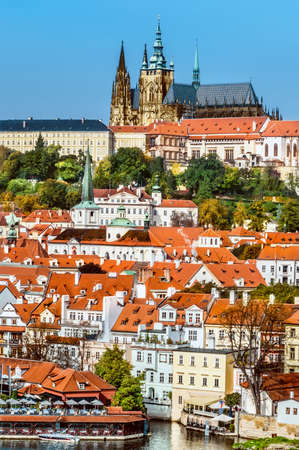 brigh: View on St. Vitus Cathedral and  Prague Castle across Vltava river on a brigh Autumn day Stock Photo