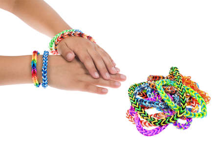 accessorize: Loom rubber bracelets on a young child