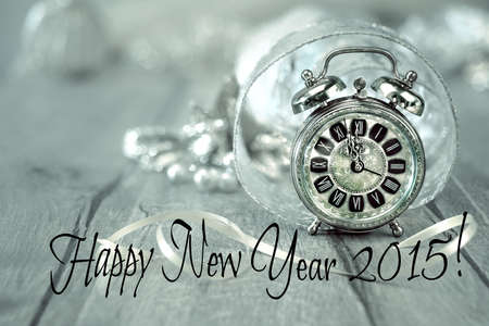 Happy New Year 2015! Wintage clock set on five to twelve with golden decorations photo