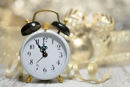 Old alarm clock set to five to midnight. Happy New Year! photo