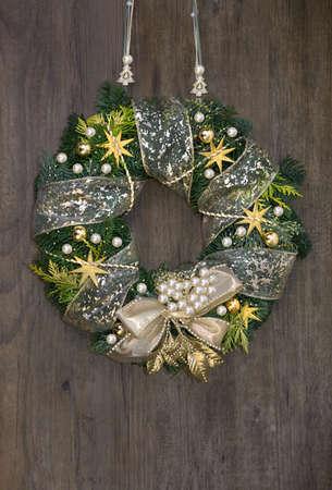 Christmas wreath withden decorations on wooden door photo