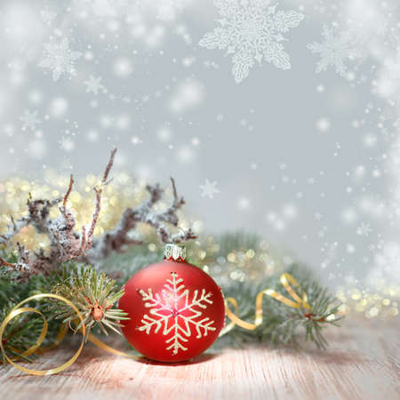 Decorated Christmas tree and red bauble, copy space